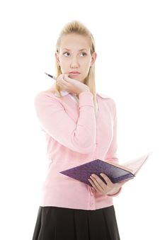 Free Pensive Blonde Girl With Pen And Diary/copybook Royalty Free Stock Image - 16439386