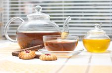 Glass Teapot,  Mug, Honey Jar And Cakes