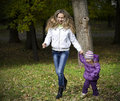 Free Mom And Daughter Running In The Park Royalty Free Stock Photography - 16444957