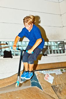 Free Boy Goes Airborne With His Scooter Royalty Free Stock Photography - 16442637