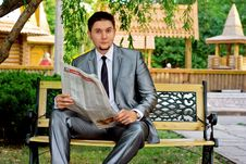 Young Businessman Reading A Newspaper Stock Image