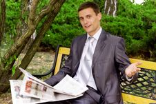 Young Businessman Reading A Newspaper Royalty Free Stock Photos