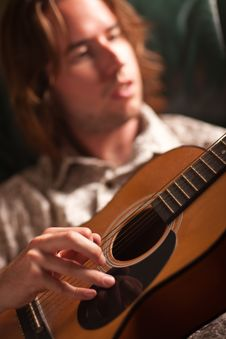 Young Musician Plays His Acoustic Guitar Stock Image