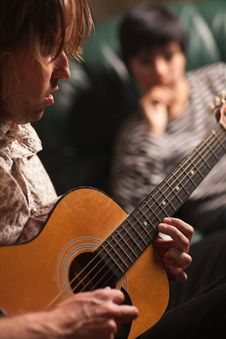 Free Musician Plays His Guitar As Friend Listens Royalty Free Stock Images - 16446639