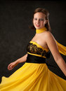 Free Young Woman In A Yellow Dress Royalty Free Stock Photography - 16457217