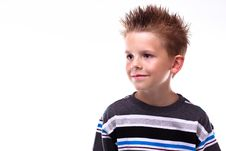 Free Cute Young Boy Smiling Looking Off Camera Stock Photo - 16450170