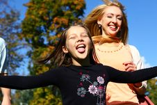 Free Two Happy Sisters Have Fun In Park Stock Photo - 16450450