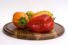 Free Colorful Paprikas On Wooden Kitchen Board Stock Images - 16450684