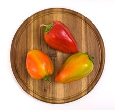 Free Colorful Paprikas On Wooden Kitchen Board Stock Photo - 16450690