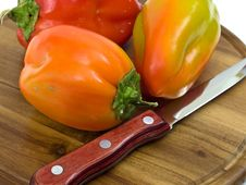 Free Colorful Paprikas On Wooden Kitchen Board Royalty Free Stock Images - 16450719