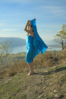 Free A Young Girl In A Blue Dress Dancing On A Mountain Stock Image - 16454911