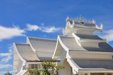 Roofs Of Wat Rong Khun Temple Against Blue Sky Royalty Free Stock Photo