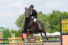 Free Jockey Jumps Over A Hurdle Royalty Free Stock Photography - 16456997