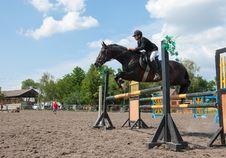 Free Jockey Jumps Over A Hurdle Stock Images - 16457054
