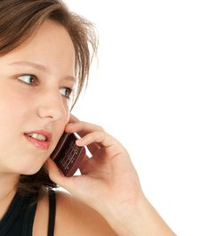 Free Young Woman Talking On Her Mobile Phone Royalty Free Stock Photography - 16457157