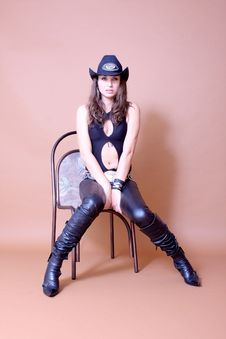 Free Cowboy Girl Sitting On The Chair Stock Photo - 16457510