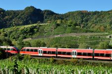 Free Red Train Green Landscape In Fall Stock Image - 16459131