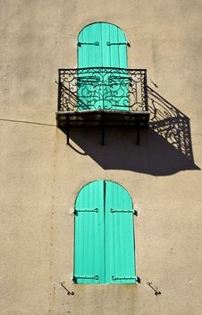 Shuttered Window With Ornate Balcony Royalty Free Stock Photo