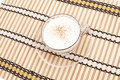 Free Cappuccino Cup On Bamboo Mat Stock Images - 16463184