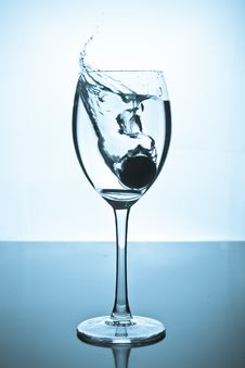 Free Splash Of Water And Coins In A Glass Stock Photo - 16460770