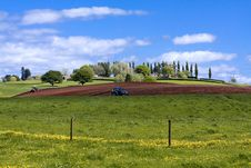 Free Tractors Working On The Spring Ploughland Royalty Free Stock Images - 16461449