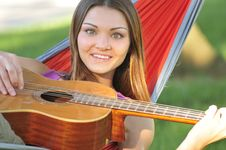 Free Girl Playing Guitar Royalty Free Stock Photo - 16461905