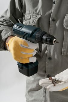 Close-up Of A Man With Drill Royalty Free Stock Photos