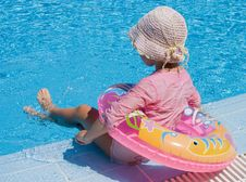 Free Little Girl With Inflatable Circle At Pool Stock Photo - 16465820