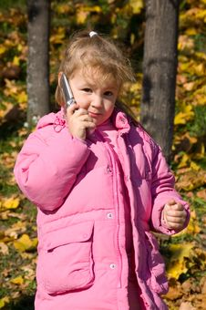 Free Little Girl Talks On A Cellular Telephone Stock Photos - 16466103