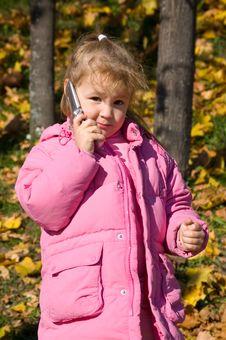 Little Girl Talks On A Cellular Telephone Stock Photos