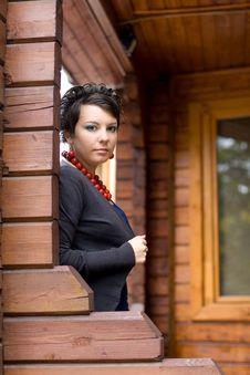 Free Girl On A Veranda Stock Image - 16468891