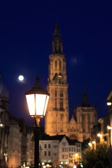 A Street Light With Cathedral Of Our Lady At Night Stock Photography