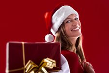 Free Smiling Santa Girl With Gifts Stock Images - 16471274