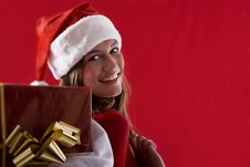 Free Smiling Santa Girl With Gifts Royalty Free Stock Images - 16471309