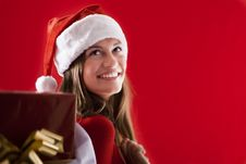 Free Smiling Santa Girl With Gifts Royalty Free Stock Photos - 16471338