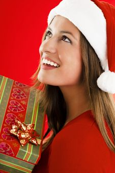 Free Santa Girl With Present Royalty Free Stock Photo - 16471775
