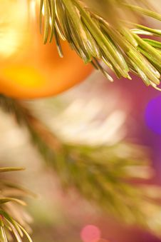 Free The Golden Christmas Ball Hangs On A Pine Branch Royalty Free Stock Images - 16472259