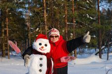 Free Woman Poses With Snowman Royalty Free Stock Photo - 16474335