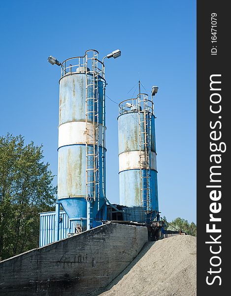 Blue cement silos in the cement factory