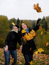 Free Two Beautiful Girl Friends With Autumn Leafs Stock Images - 16489744