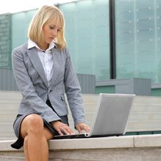 Free A Young Businesswoman Is Working Outdoors Stock Images - 16480594