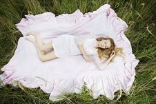 Free Woman Lying On A Sheet In Field Stock Photo - 16481450