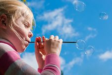 Free Girl Starting Up Soap Bubbles Stock Photography - 16482792