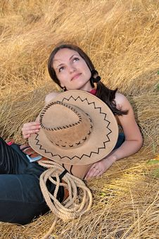 Free Beautiful Woman Lying In The Straw With The Hat Stock Photography - 16482922