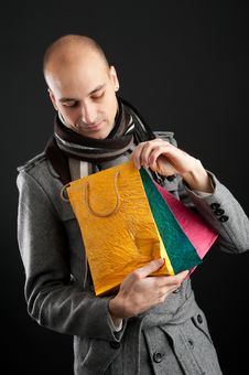 Free Young Man With Shopping Bags Stock Photos - 16484703