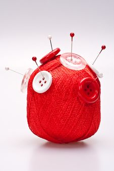 Free Pins In Wool Ball With Buttons Stock Photo - 16484950