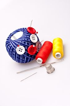 Free Pins In Wool Ball With Buttons Stock Photography - 16485072