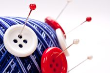 Pins In Wool Ball With Buttons Royalty Free Stock Photography