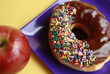 Free Chocolate Glazed Doughnut And Apple Stock Photo - 16488990