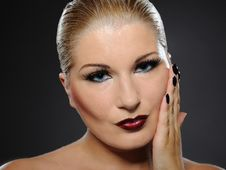 Pretty Woman Face With Perfect Lips And Black Nail Stock Photo